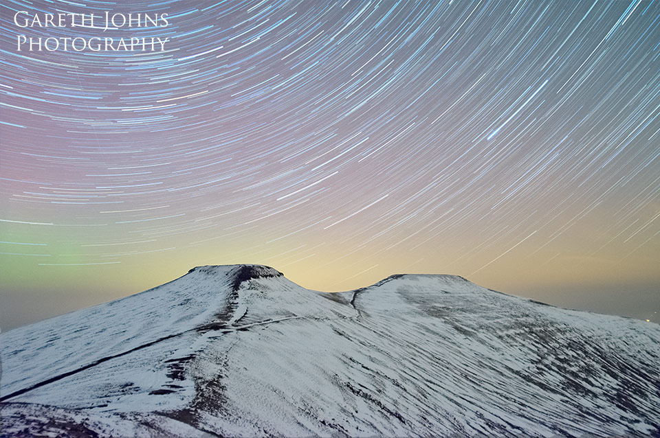 Corn Du and Pen y fan star trail with aurora borealis