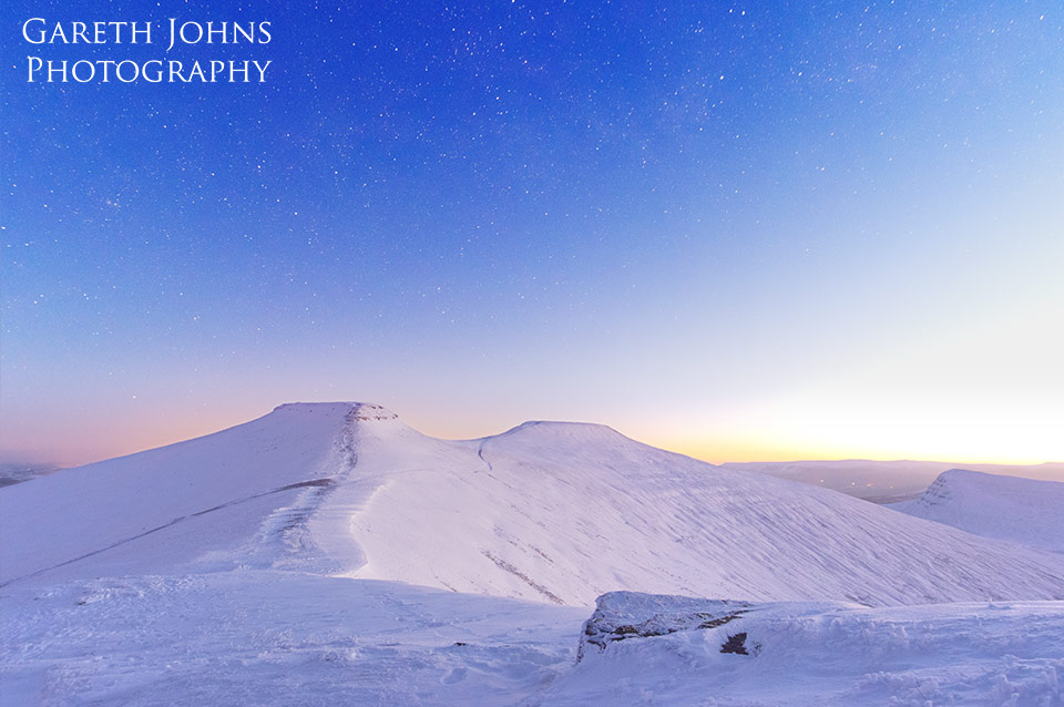 Dawn breaking over a frozen Pen y Fan